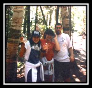 An old camping trip with my sister and brothers...being eaten alive by bugs! (My other brother is taking the picture.)